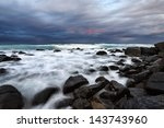 Ocean Crashing Over Rocks At...