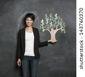 Small photo of Happy Asian Business woman in front of chalk money tree drawing on blackboard.