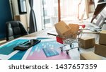 e commerce. paper boxes in... | Shutterstock . vector #1437657359