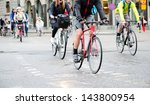 Bicyclists on their way home - stock photo