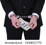 Businessman In Handcuffs Hold...