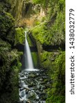 waterfall over the hiking path... | Shutterstock . vector #1438032779