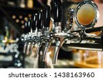 Close Up Of Beer Taps In Row....