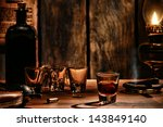 Stock photo american west legend whisky shot glass drink with empty glasses and vintage whiskey bottle on 143849140