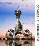 Wizards tower. Fantasy tower sitting on a rock Island with sunset background - stock photo