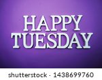 Small photo of Happy Tuesday wooden letter alphabet on purple background
