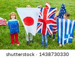Children in international kindergarten with national flags as a symbol of diversity - stock photo