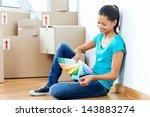 woman choosing paint colour... | Shutterstock . vector #143883274