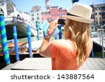 woman in venice taking picture... | Shutterstock . vector #143887564