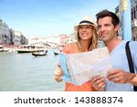 cheerful tourists with city map ... | Shutterstock . vector #143888374