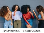 friends leaning to a grey wall... | Shutterstock . vector #1438920206