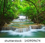 waterfall in the forest... | Shutterstock . vector #143909674