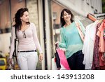 two young women shopping in the ... | Shutterstock . vector #143913208