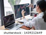 Small photo of Business team investment working with computer, planning and analyzing graph stock market trading with stock chart data, business financial investment and technology concept.