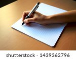 Hand Writing In A Notebook Wit...