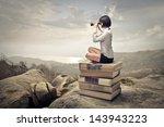 beautiful woman sitting on a... | Shutterstock . vector #143943223