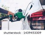 Man Handle Pumping Gasoline...
