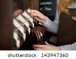 Saleswoman Filling Coffee Beans ...