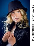 beautiful blonde girl wearing a ... | Shutterstock . vector #143961958
