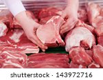 closeup of butcher's hands... | Shutterstock . vector #143972716