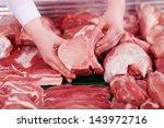 closeup of butcher's hands... | Shutterstock . vector #143972716