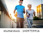 mature couple is doing sport... | Shutterstock . vector #1439755916
