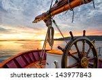 sunrise at sea on a tall ship... | Shutterstock . vector #143977843