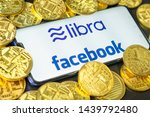 Small photo of Bangkok, Thailand - July 2, 2019: Phone shows Libra logo on the screen. Facebook reported to utilize new cryptocurrency called Libra. Libra was reported to be used for purchases in Facebook and other.