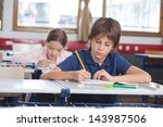 little boy writing notes while... | Shutterstock . vector #143987506