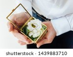groom holding wedding rings in... | Shutterstock . vector #1439883710