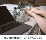 laptop on the bed and female... | Shutterstock . vector #1439917730