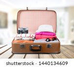 Suitcase With Clothes And Othe...