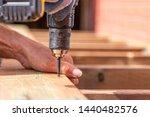 Strong Hands Preparing Wooden...