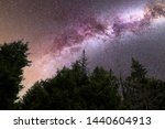 a view of a meteor shower and... | Shutterstock . vector #1440604913