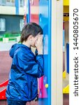 teenager plays hide and seek... | Shutterstock . vector #1440805670
