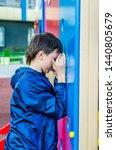 teenager plays hide and seek... | Shutterstock . vector #1440805679