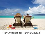 couple on a tropical beach at... | Shutterstock . vector #144105316