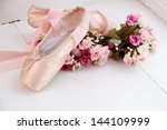 new pointe with flowers lying... | Shutterstock . vector #144109999