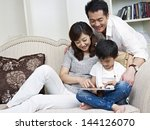 mother  father and son looking... | Shutterstock . vector #144126070