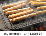 cooking sausages on the... | Shutterstock . vector #1441268519