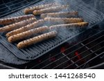 cooking sausages on the... | Shutterstock . vector #1441268540