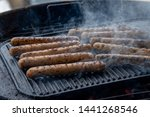 cooking sausages on the... | Shutterstock . vector #1441268546