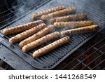 cooking sausages on the... | Shutterstock . vector #1441268549