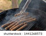 cooking sausages on the... | Shutterstock . vector #1441268573