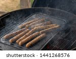 cooking sausages on the... | Shutterstock . vector #1441268576