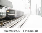 Train In Snowstorm Departing...