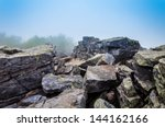 Large boulders in fog on...