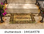 welcome mat sitting at the... | Shutterstock . vector #144164578