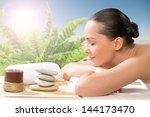 beautiful spa woman lying on... | Shutterstock . vector #144173470