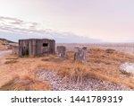 WW2 coastal beach defences with concrete anti tank blocks and a pillbox